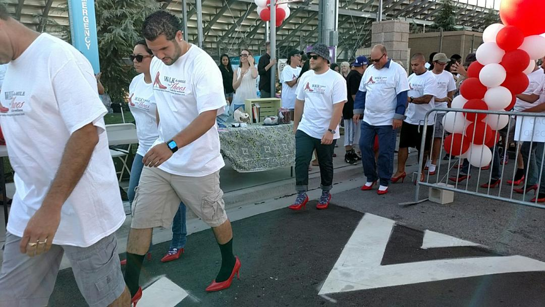 From 2015: Here's a portion of the start of the 1-mile walk with a few of the men in their shoes!