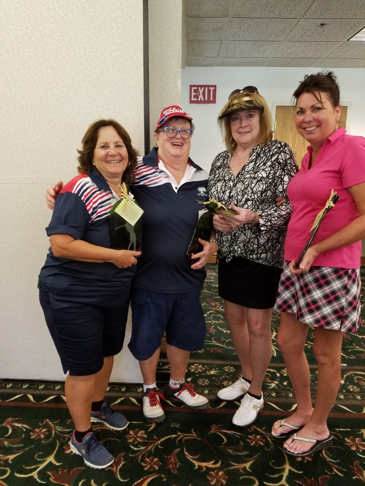 Second-place women, from left: Pat Stevenson, Sally Sweznick, Elaine Friend, Valerie Copeland