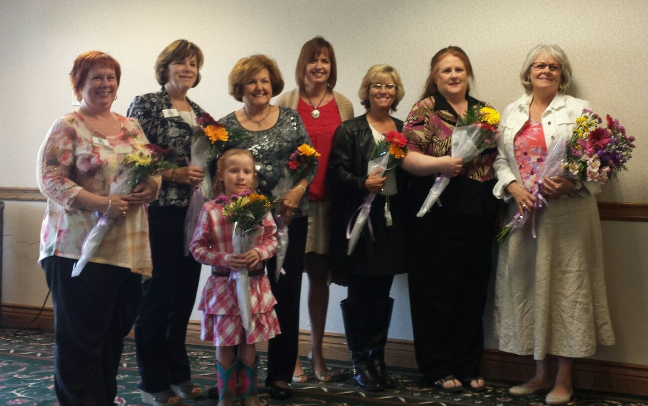 From left: Denise German, Treasurer; Rose Rockey, VP Membership (in front of Rose is her granddaughter Raegan); Sandra Murphy, VP Facilities; Mary Courtney, VP Resource Development; Secretary, Dondra Arcidiacono; 1st VP Strategic Planning, Fay Harrison-Bergier; and our new President Cei Kratz.